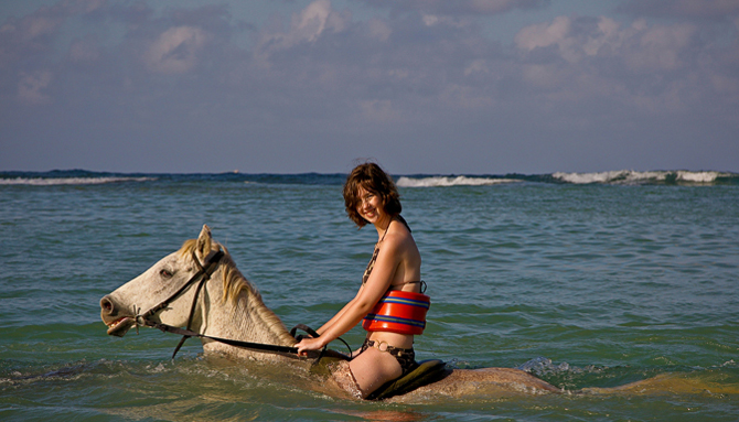 Photo Showing Woman Riding Horse